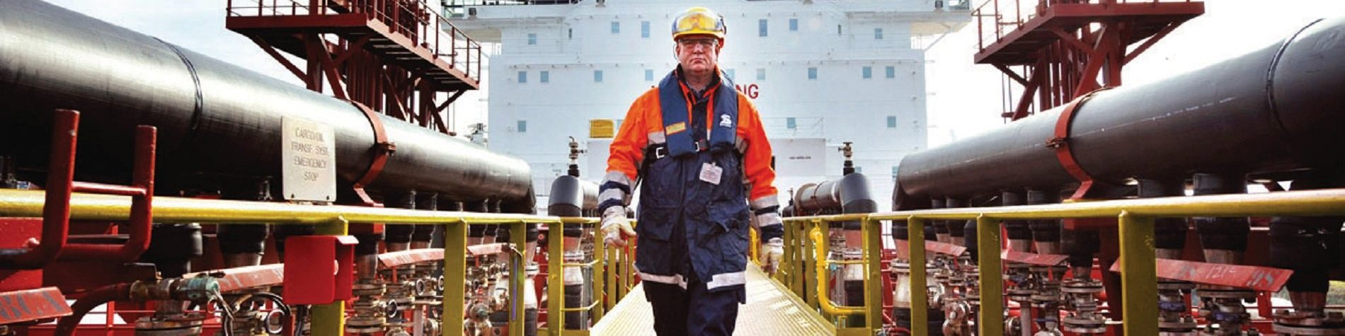 worker walking around a Shell vessel