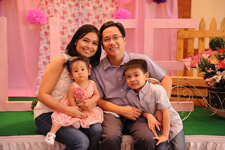 Donna Kuizon Cruz with her partner and two children