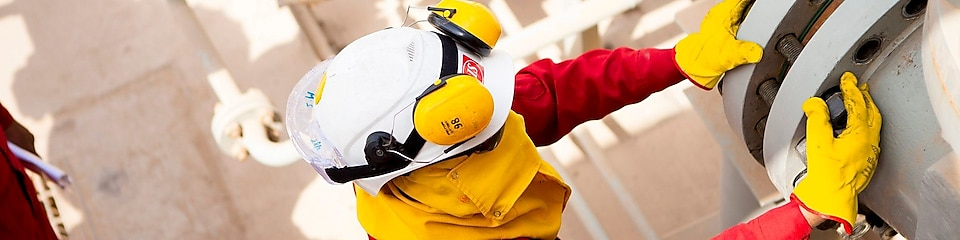 Worker wearing safety mask and gloves