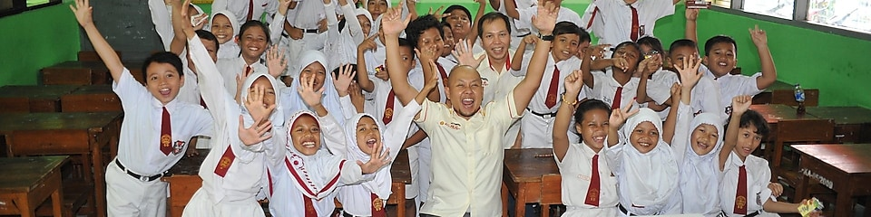 Students in a classroom cheering